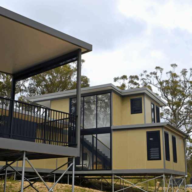 Shows a double storey panelised modular house. This method minimised wasted time, labour and materials