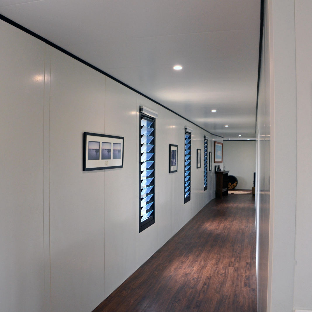 A long straight corridor wall show the on-site precision gained when using the MAAP hybrid modualr system